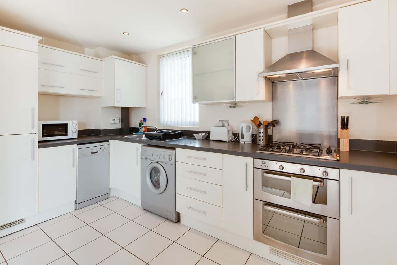 ur stay serviced apartments Grand Duplex kitchen